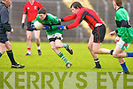 Diarmuid O Herlihy of Mercy Mounthawk, Football team makes adash for goal and Martin Flavin of St Michaels Listowel gives chase..
