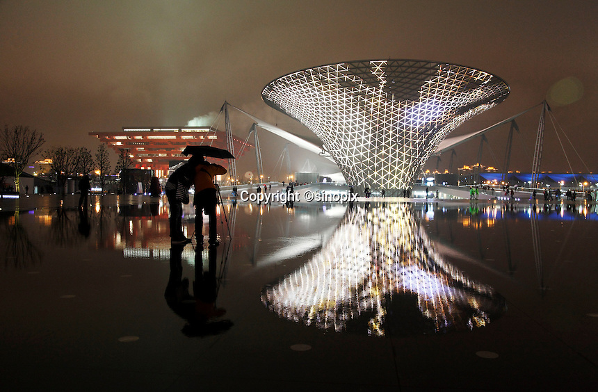 Visitors walk past illuminated funnel like structures of Sunshine Valley during the first day of the trail run for the 2010 World Expo in Shanghai, China..20 Apr 2010