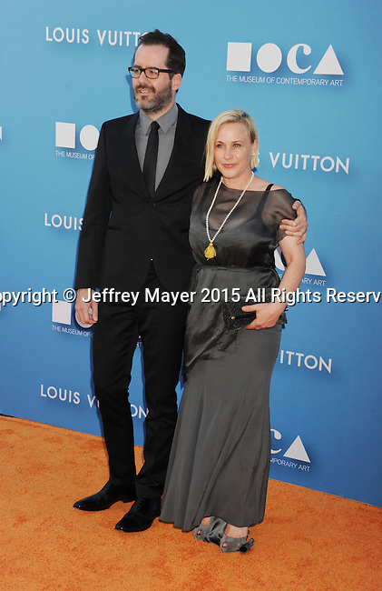 LOS ANGELES, CA - MAY 30: Actress Patricia Arquette (R) and Eric White arrive at the 2015 MOCA Gala presented by Louis Vuitton at The Geffen Contemporary at MOCA on May 30, 2015 in Los Angeles, California.