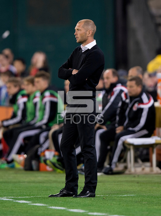 Columbus Crew head coach Gregg Berhalter watches his team during a MLS game at RFK Stadium in Washington, DC.  D.C. United lost to the Columbus Crew, 3-0.