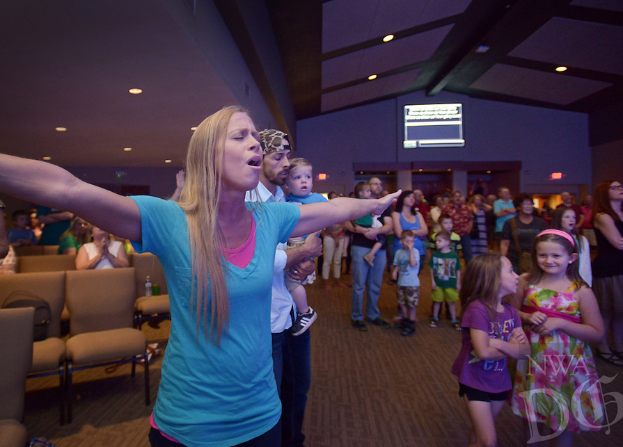 NWA Democrat-Gazette/BEN GOFF @NWABENGOFF<br /> Hannah Wood sings along with the worship team on Saturday June 4, 2016 during a ribbon-cutting and 'big reveal' for the newly renovated auditorium at New Life Christian Church in Bella Vista. The church was opened in 1974 as Bella Vista Christian Church and has undergone several expansions over the years. The church rebranded itself New Life Christian at the beginning of the year and began the renovation project for the auditorium on March 28.