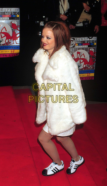 "SHIRLEY FROM ""GARBAGE""    ..white fur coat, trainers, full length, full-length..www.capitalpictures.com..sales@capitalpictures.com..©Capital Pictures"