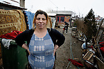 "THIS PHOTO IS AVAILABLE AS A PRINT OR FOR PERSONAL USE. CLICK ON ""ADD TO CART"" TO SEE PRICING OPTIONS.   Giltena Duda in front of her home in the Zemun Polje Roma neighborhood of Belgrade, Serbia. Ms. Duda is pregnant with her seventh child. She and her husband are Roma refugees from Kosovo, and thus legally marginalized in Serbia. They built their home on unregistered land and pirate their electrical hookup. Without legal residency, their children can't attend a regular school, and they have difficulties getting formal employment. Yet both participate in an adult literacy program sponsored by the Branko Pesic School, where their children attend classes. The school is supported by Church World Service."