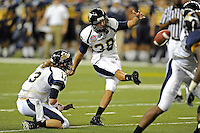 26 December 2010:  FIU kicker Jack Griffin (38) kicks an extra point in the fourth quarter as the FIU Golden Panthers defeated the University of Toledo Rockets, 34-32, to win the 2010 Little Caesars Pizza Bowl at Ford Field in Detroit, Michigan.