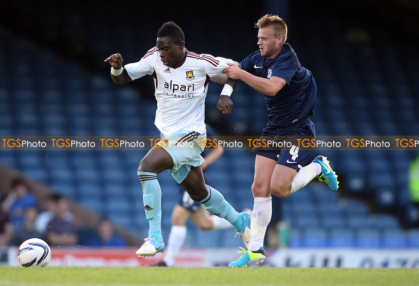 Pelly Ruddock of West Ham gets away from Conor Clifford of Southend - Southend United vs West Ham United XI, Pre-Season Friendly at Roots Hall, Southend - 29/07/13 - MANDATORY CREDIT: Rob Newell/TGSPHOTO - Self billing applies where appropriate - 0845 094 6026 - contact@tgsphoto.co.uk - NO UNPAID USE