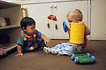 Palo Alto CA Wary baby, 11 months, protecting his toy from another baby, 12 months at day care