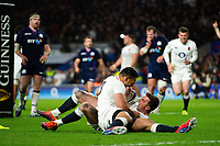 George Ford of England celebrates his late try with team-mate Ben Te'o. Guinness Six Nations match between England and Scotland on March 16, 2019 at Twickenham Stadium in London, England. Photo by: Patrick Khachfe / Onside Images