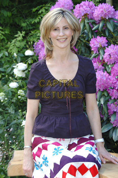 JULIA CARLING.Opens The Wildlife Trusts Lush Garden,.Press Day at the Royal Horticultural Society's Chelsea Flower Show, Royal Hospital, Chelsea, London, .May 23rd 2005..half length printed patterned long skirt sitting.Ref: PL.www.capitalpictures.com.sales@capitalpictures.com.©Capital Pictures