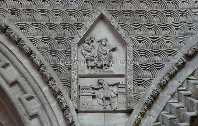 Harold's oath, sculpture based on scene 23 of the Bayeux Tapestry, 19th century,  between Romanesque arches, south side of Nave arcade, 12th century, Bayeux Cathedral (Notre Dame de Bayeux), 11th-19th century, Bayeux, France. The Romanesque section of the Cathedral, dedicated 1077, was reconstructed after 12th century war between the sons of William the Conqueror. Here William forced Harold to take the oath which led to the Norman Conquest of England. Gothic and Neo-Gothic sections were added until the 19th century. Photograph by Manuel Cohen.