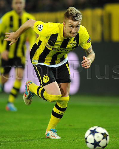 09.04.2013 Dortmund, Germany. Dortmund's Marco Reus plays the ball during the UEFA Champions League quarter final second leg soccer match between Borussia Dortmund and Malaga.