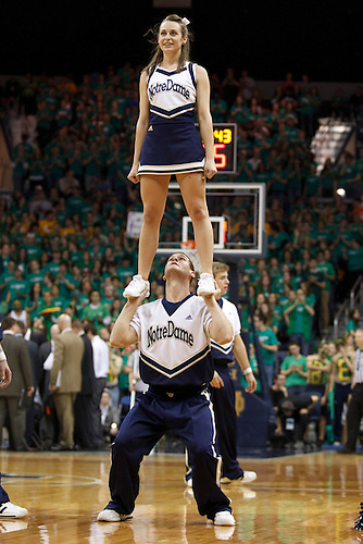 Notre Dame cheerleader Allie Rzepczynski performs during NCAA Men's basketball game between Marquette and Notre Dame.  The Notre Dame Fighting Irish defeated the Marquette Golden Eagles 76-59 in game at Purcell Pavilion at the Joyce Center in South Bend, Indiana.