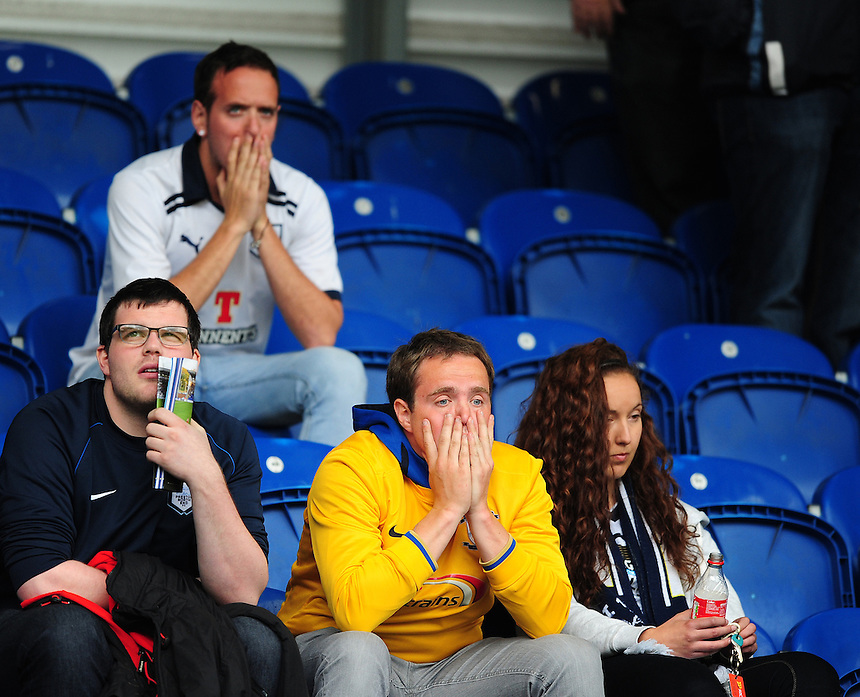 Preston North End fans at the end of the game after it was confirmed the club had missed out on automatic promotion<br /> <br /> Photographer Chris Vaughan/CameraSport<br /> <br /> Football - The Football League Sky Bet League One - Colchester United v Preston North End - Sunday 3rd May 2015 - Weston Homes Community Stadium - Colchester<br /> <br /> &copy; CameraSport - 43 Linden Ave. Countesthorpe. Leicester. England. LE8 5PG - Tel: +44 (0) 116 277 4147 - admin@camerasport.com - www.camerasport.com