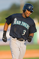 Dwight Britton #3 of the Pulaski Mariners rounds the bases after hitting a home run at Burlington Athletic Park August 4, 2009 in Burlington, North Carolina. (Photo by Brian Westerholt / Four Seam Images)