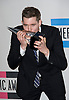 "MICHAEL BUBLE WITH AWARD.American Music Awards 2010,Nokia Rheatre, Los Angeles_21/10/2010.Mandatory Photo Credit: ©Dias/Newspix International..**ALL FEES PAYABLE TO: ""NEWSPIX INTERNATIONAL""**..PHOTO CREDIT MANDATORY!!: NEWSPIX INTERNATIONAL(Failure to credit will incur a surcharge of 100% of reproduction fees)..IMMEDIATE CONFIRMATION OF USAGE REQUIRED:.Newspix International, 31 Chinnery Hill, Bishop's Stortford, ENGLAND CM23 3PS.Tel:+441279 324672  ; Fax: +441279656877.Mobile:  0777568 1153.e-mail: info@newspixinternational.co.uk"