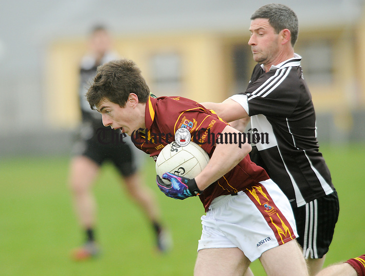 Kieran Malone of Miltown in action against James Griffin of Doonbeg during their Cusack Cup game at Miltown. Photograph by John Kelly.