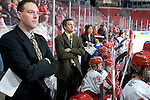 MADISON, WI - FEBRUARY 11: Assistant coach Dan Koch, from left, head coach Mark Johnson and assistant Tracey Cornell of the Wisconsin Badgers women's hockey look on during the game against the Ohio State Buckeyes at the Kohl Center on February 11, 2007 in Madison, Wisconsin. The Badgers beat the Buckeyes 3-2. (Photo by David Stluka)