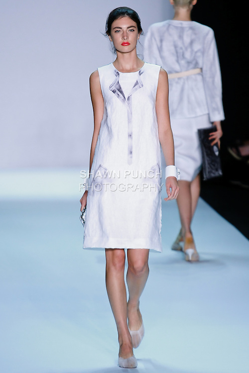 Model walks the runway in an outfit by Isaac Mizrahi for the Isaac Mizrahi Spring 2011 fashion show, during Mercedes-Benz Fashion Week, September 16, 2010.