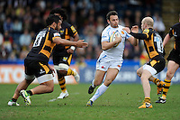 Phil Dollman of Exeter Chiefs runs into Joe Simpson (right) and Billy Vunipola of London Wasps during the Aviva Premiership match between London Wasps and Exeter Chiefs at Adams Park on Sunday 21st April 2013 (Photo by Rob Munro)