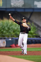Quad Cities River Bandits third baseman Nick Tanielu (30) warmup throw to first during the first game of a doubleheader against the Wisconsin Timber Rattlers on August 19, 2015 at Modern Woodmen Park in Davenport, Iowa.  Quad Cities defeated Wisconsin 3-2.  (Mike Janes/Four Seam Images)
