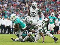 04.10.2015. Wembley Stadium, London, England. NFL International Series. Miami Dolphins versus New York Jets. Miami Dolphins Wide Receiver Jarvis Landry is tackled to the ground.