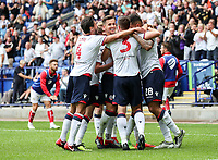 Bolton Wanderers' Josh Magennis celebrates scoring with team mates<br /> <br /> Photographer Andrew Kearns/CameraSport<br /> <br /> The EFL Sky Bet Championship - Bolton Wanderers v Bristol City - Saturday August 11th 2018 - University of Bolton Stadium - Bolton<br /> <br /> World Copyright &copy; 2018 CameraSport. All rights reserved. 43 Linden Ave. Countesthorpe. Leicester. England. LE8 5PG - Tel: +44 (0) 116 277 4147 - admin@camerasport.com - www.camerasport.com