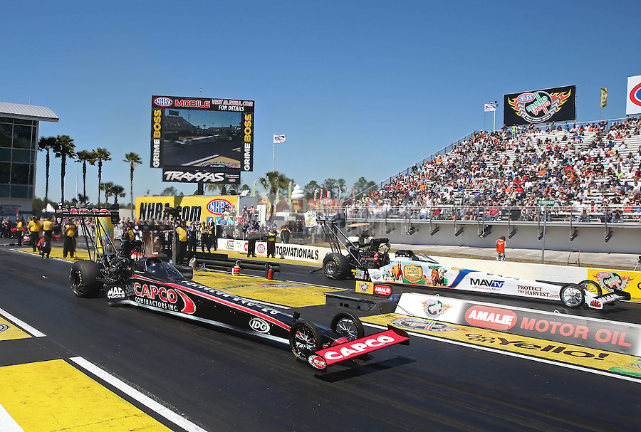 Mar. 16, 2013; Gainesville, FL, USA; NHRA top fuel dragster driver Steve Torrence (near lane) races alongside Brandon Bernstein during qualifying for the Gatornationals at Auto-Plus Raceway at Gainesville. Mandatory Credit: Mark J. Rebilas-