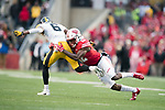 Wisconsin Badgers defensive back Natrell Jamerson (12) tackles Iowa Hawkeyes wide receiver Ihmir Smith-Marsette (6) during an NCAA College Big Ten Conference football game against the Iowa Hawkeyes Saturday, November 11, 2017, in Madison, Wis. The Badgers won 38-14. (Photo by David Stluka)