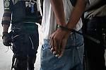 Elections day in Haiti / Dia de Elecciones presidenciales en Hait. Un haitiano es detenido. Photo by Jose L. Cuesta