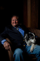 Montana Governor Brian Schweitzer and his dog, Jag, at the state's capitol building in Helena, Montana.