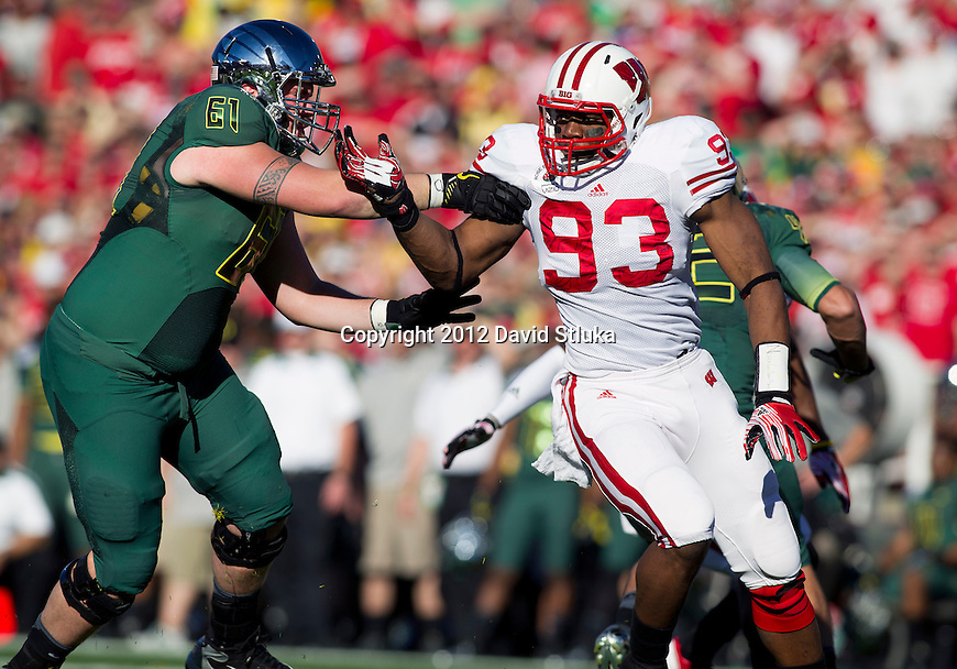 Wisconsin Badgers defensive lineman Louis Nzegwu (93) battles against Oregon Ducks offensive lineman Nick Cody (61) during the 2012 Rose Bowl NCAA football game in Pasadena, California on January 2, 2012. The Ducks won 45-38. (Photo by David Stluka)