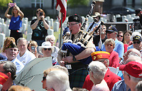 NWA Democrat-Gazette/DAVID GOTTSCHALK  Dennis Sisson, with the Ozark Highlanders Pipe Band, plays Amazing Grace Monday, May 29, 2017,  during the Folding of the Flag at the  Memorial Day 2017 Ceremony at Fayetteville National Cemetery.   The ceremony included traditional Color presentations, Rifle Volley, memorial wreath recognition and keynote speaker Governor Asa Hutchinson.