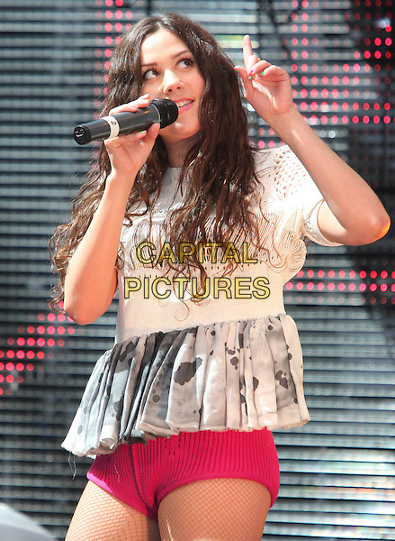 ELIZA DOOLITTLE .'Future Flames' Coca Cola launches London 2012 Olympic Torch Relay nominations at Westfield Shopping Centre, London, England..June 1st 2011.half length music on stage live concert gig performing microphone white top grey gray print pink red knickers shorts hotpants singing hand finger  .CAP/ROS.©Steve Ross/Capital Pictures
