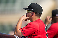 Kannapolis Intimidators manager Justin Jirschele (9) watches the action from the dugout during the game against the Hagerstown Suns at Kannapolis Intimidators Stadium on June 14, 2017 in Kannapolis, North Carolina.  The Intimidators defeated the Suns 4-1 in game one of a double-header.  (Brian Westerholt/Four Seam Images)