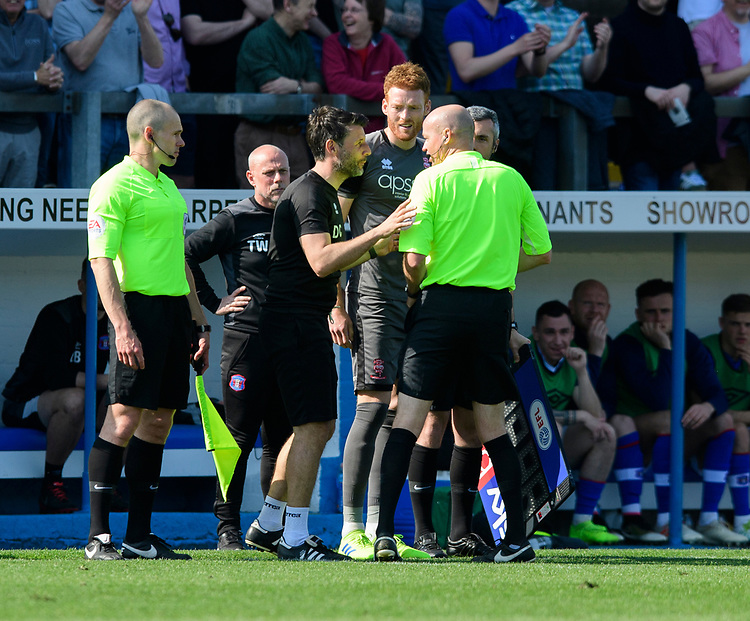 Lincoln City manager Danny Cowley, left, speaks to Referee Lee Mason after Lincoln City's Cian Bolger was shown a yellow card <br /> <br /> Photographer Chris Vaughan/CameraSport<br /> <br /> The EFL Sky Bet League Two - Carlisle United v Lincoln City - Friday 19th April 2019 - Brunton Park - Carlisle<br /> <br /> World Copyright © 2019 CameraSport. All rights reserved. 43 Linden Ave. Countesthorpe. Leicester. England. LE8 5PG - Tel: +44 (0) 116 277 4147 - admin@camerasport.com - www.camerasport.com