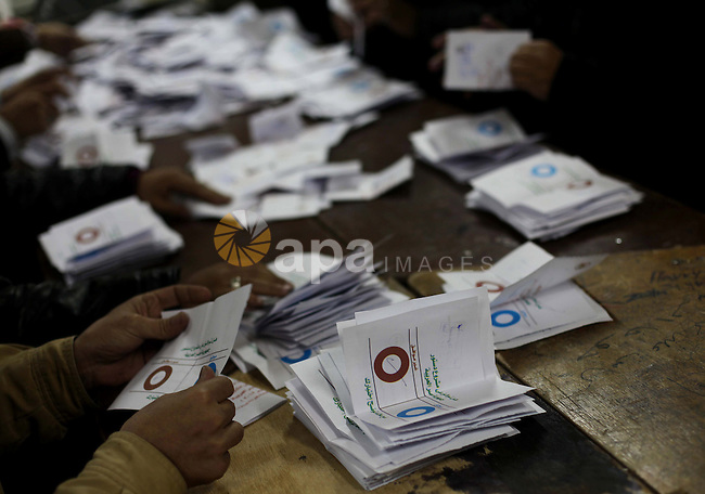 Officials count ballots after polls closed in Giza, south of Cairo, on December 22, 2012. Egyptians are voting in the final round of a referendum on a new constitution championed by President Mohamed Morsi and his Islamist allies against fierce protests from the secular-leaning opposition. Photo by Ashraf Amra