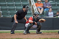 Kannapolis Intimidators catcher Evan Skoug (9) sets a target as home plate umpire Colin Baron looks on during the game against the Rome Braves at Kannapolis Intimidators Stadium on April 7, 2019 in Kannapolis, North Carolina. The Intimidators defeated the Braves 2-1. (Brian Westerholt/Four Seam Images)