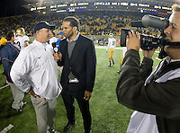 California head coach Jeff Tedford gets interviewed with Pac-12 Network TV after the game against UCLA at Memorial Stadium in Berkeley, California on October 6th, 2012.  California defeated UCLA, 43-17.