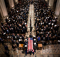 The Honor Guard carries the casket of former president George Herbert Walker Bush down the center isle following a memorial ceremony at the National Cathedral in Washington, Wednesday,  Dec.. 5, 2018. <br /> Credit: Doug Mills / Pool via CNP / MediaPunch