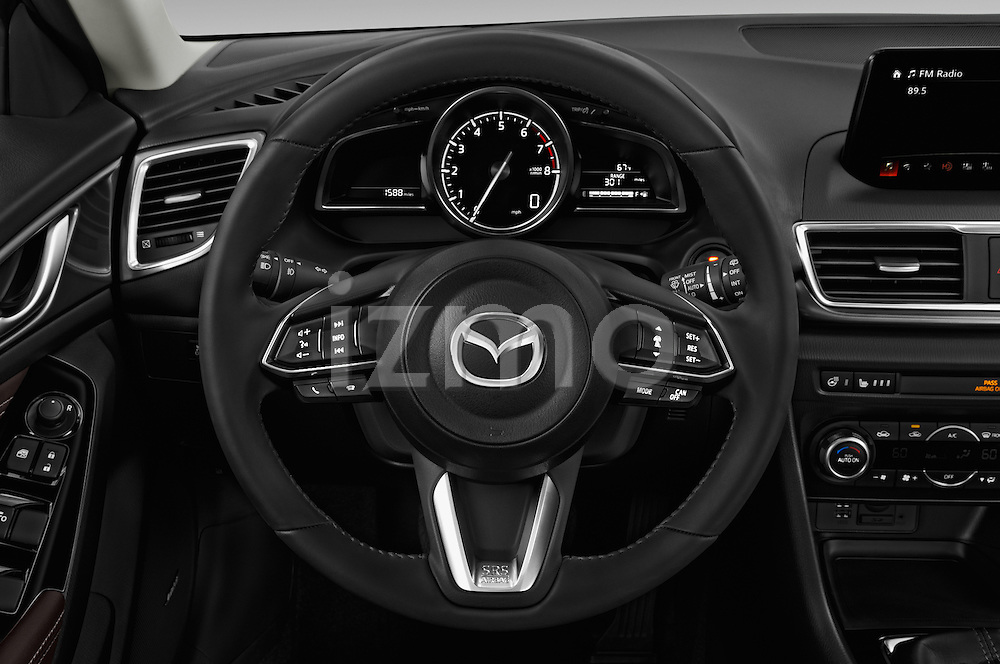 Car pictures of steering wheel view of a 2017 Mazda Mazda3 Grand-Touring 5 Door Hatchback Steering Wheel