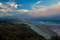 Clouds, tinged with sunset light, over the central Oregon coast between Florence and Yachats.