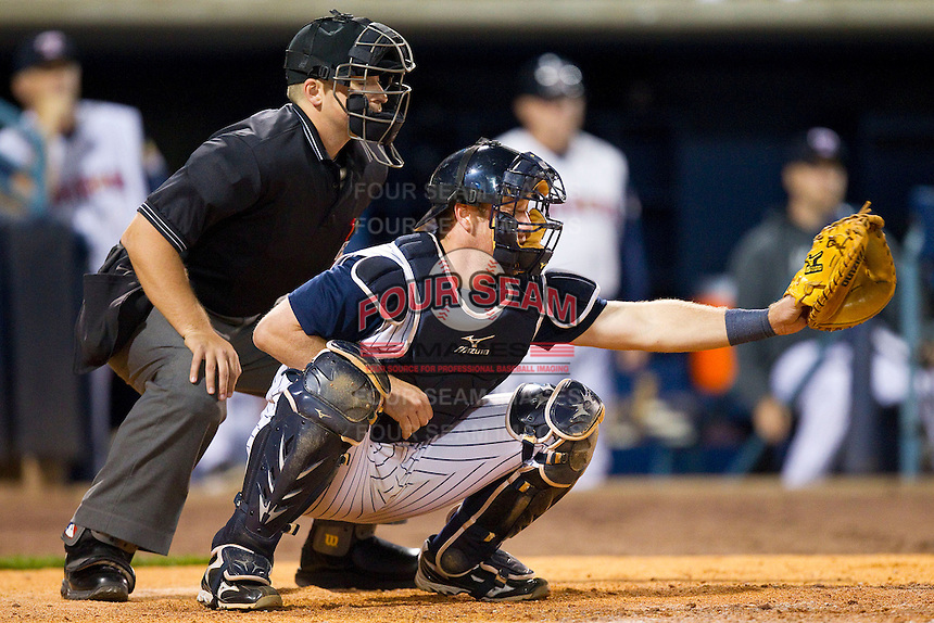 Toledo Mudhens catcher Bryan Holaday (16) sets a target as home plate umpire Jeff Gosney looks on during the International League game against the Charlotte Knights at 5/3 Field on May 3, 2013 in Toledo, Ohio.  The Knights defeated the Mudhens 10-2.  (Brian Westerholt/Four Seam Images)
