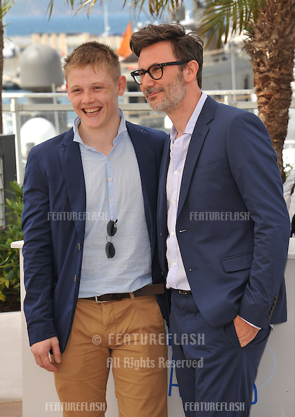 Maxim Emelianov &amp; director Michel Hazanavicius at the photocall for their movie &quot;The Search&quot; at the 67th Festival de Cannes.<br /> May 21, 2014  Cannes, France<br /> Picture: Paul Smith / Featureflash