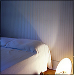 Bedroom with overturned lamp