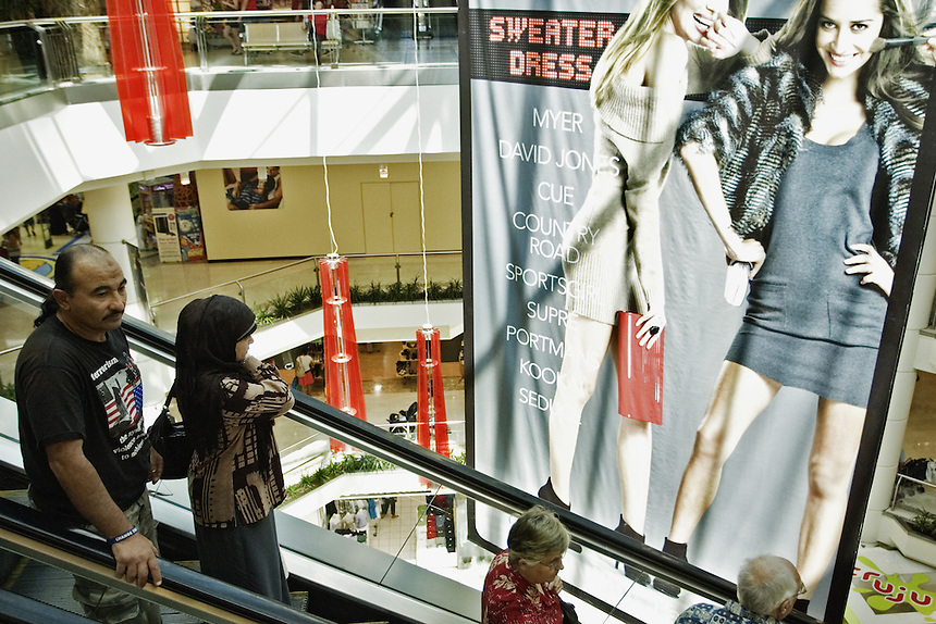 Habib and his wife, Maha, stand on an escalator at a shopping mall in Parramatta, western Sydney, March 2007.