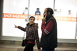 December 16, 2010. Raleigh, NC.. After TP Mishra picks up his wife Renuka Adhikari from her first job at a shopping mall, they go to get a snack, before he has to drop her off at her second job, in food service. . TP Mishra, a refugee from Bhutan, has recently relocated from the Bronx to Raleigh, where he lives in an suburban apartment  with his wife, as well as another Bhutanese couple.
