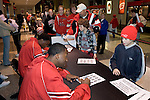 MADISON, WI - OCTOBER 24: Senior forward Alando Tucker #42 of the Wisconsin Badgers sings an autograph for a fan at the Kohl Center on October 24, 2006 in Madison, Wisconsin. (Photo by David Stluka)
