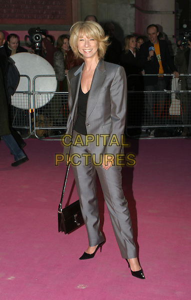 HELEN WORTH.Private view to open the V&A's major Westwood exhibition.30 March 2004.full length, full-length, grey trouser suit.www.capitalpictures.com.sales@capitalpictures.com.© Capital Pictures.