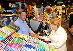 26-06-2014: Donagh Gleeson serving local customer Anne O'Shea  at the reopening of Gleeson's Spar shop in Killarney on Thursday. The shop had been closed since a fatal  gas explosion last July that unfortunately claimed the life of Donagh's brother James Gleeson.  Picture: Eamonn Keogh (MacMonagle, Killarney)