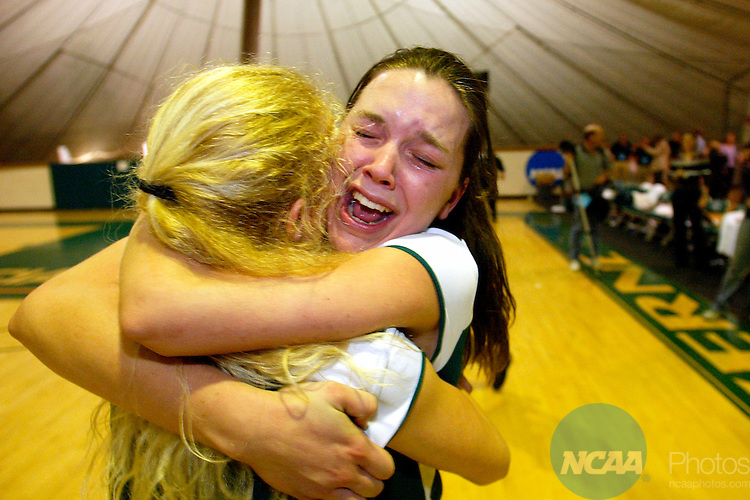 06 DEC 2003:  Cindy McPeak (17) and Kara Liefer (8) of Washington University celebrate their victory over New York University during the Division III Women's Volleyball Championship held at the Russell J. Frantz Athletic Court on the University of La Verne campus in La Verne, CA.  Washington defeated NYU 30-26, 32-30, 30-22 for the national title.  Kevin Sullivan/NCAA Photos