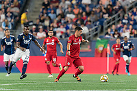 FOXBOROUGH, MA - AUGUST 31: Marco Delgado #8 of Toronto FC controls the ball as Luis Caicedo #27 of New England Revolution closes during a game between Toronto FC and New England Revolution at Gillette Stadium on August 31, 2019 in Foxborough, Massachusetts.